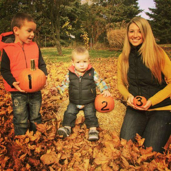 baby announcement with siblings and pumpkins