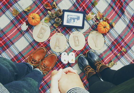 fall baby reveal with pumpkin